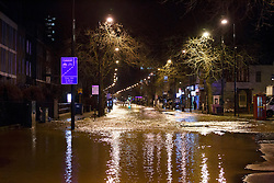 © licensed to London News Pictures. London, UK 27/02/2014. Scenes from Clapham Road in south London where a burst main has flooded the area.on Thursday, 27 February 2014. Photo credit: Tolga Akmen/LNP