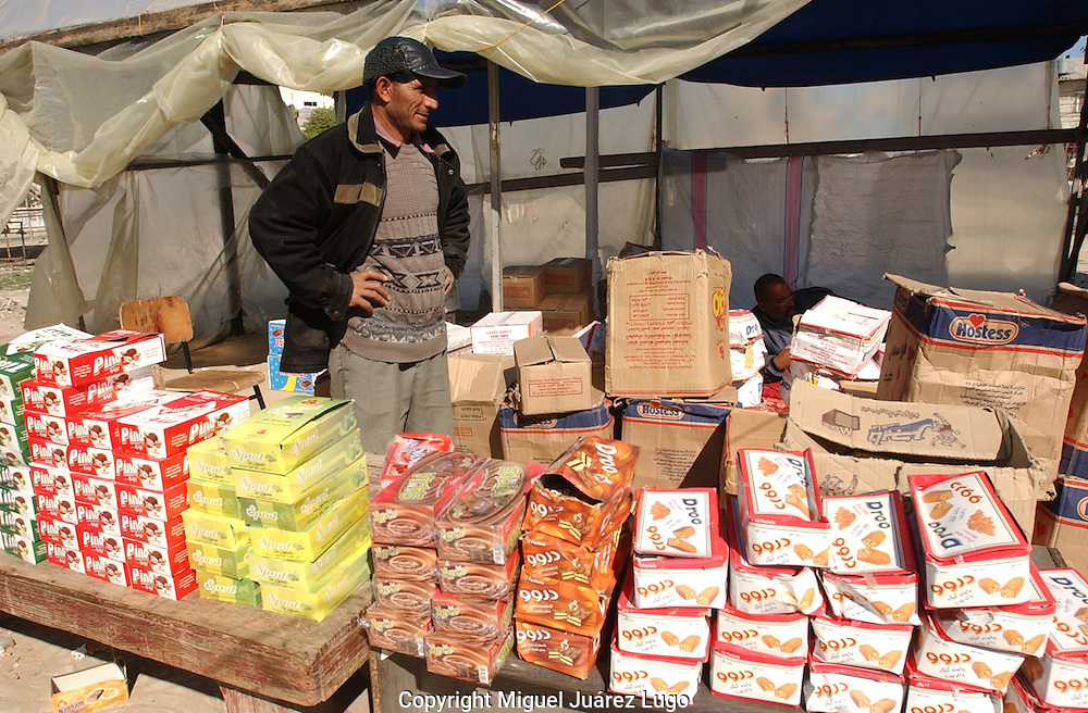Rafah, Gaza. A vendor stands by his products, in this case egytpian cookies, as he waits for shoppers in the Star Market in the Village of Rafah, Gaza, on Wednesday morning.  All the products on sale in this place had been smuggled through the tunnels systems along the Palestinian-Egyptian border.  Two weeks after the Israeli military campaign and several bombing raids the products keep on passing.  (PHOTO: MIGUEL JUAREZ)