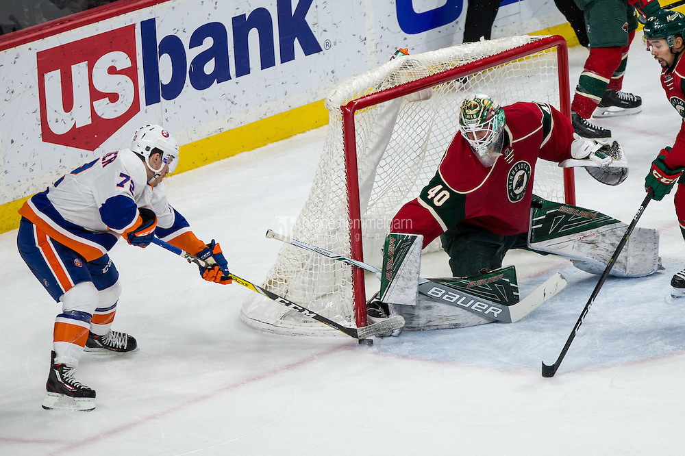 Dec 29, 2016; Saint Paul, MN, USA; Minnesota Wild goalie Devan Dubnyk (40) makes a save on New York Islanders forward Anthony Beauvillier (72) during the third period at Xcel Energy Center. The Wild defeated the Islanders 6-4. Mandatory Credit: Brace Hemmelgarn-USA TODAY Sports