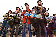 CHINA, FENGDU:  Vendors agressively selling souvenirs and books about the Three Gorges Dam meet the cruise ships that stop at Fengdu during a Yangtze River Cruise. Photo Illustration.
