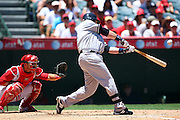ANAHEIM, CA - JULY 12:  Eric Hinske #14 of the New York Yankees takes a swing at a pitch during the game against the Los Angeles Angels of Anaheim at Angel Stadium on Sunday, July 12, 2009 in Anaheim, California.  The Angels defeated the Yankees 5-4 and swept the three game series.  (Photo by Paul Spinelli/MLB Photos via Getty Images)  *** Local Caption *** Eric Hinske