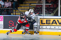 KELOWNA, CANADA - MARCH 18: Tyson Baillie #24 of Kelowna Rockets checks Nolan Volcan #26 of Seattle Thunderbirds into the boards on March 18, 2015 at Prospera Place in Kelowna, British Columbia, Canada.  (Photo by Marissa Baecker/Shoot the Breeze)  *** Local Caption *** Tyson Baillie; Nolan Volcan;