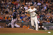 San Francisco Giants third baseman Conor Gillaspie (21) throws to first base against the Colorado Rockies at AT&T Park in San Francisco, Calif., on September 27, 2016. (Stan Olszewski/Special to S.F. Examiner)