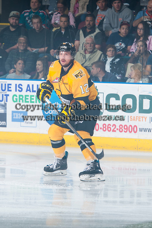 KELOWNA, CANADA - MAY 13: Reid Gow #12 of Brandon Wheat Kings skates against the Kelowna Rockets on May 13, 2015 during game 4 of the WHL final series at Prospera Place in Kelowna, British Columbia, Canada.  (Photo by Marissa Baecker/Shoot the Breeze)  *** Local Caption *** Reid Gow;