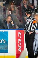 KELOWNA, BC - NOVEMBER 16:  Referee Fraser Lawrence stands at the time keepper's box while a Kelowna Rockets goal is reviewed by the video goal judges against the Kamloops Blazers at Prospera Place on November 16, 2019 in Kelowna, Canada. (Photo by Marissa Baecker/Shoot the Breeze)