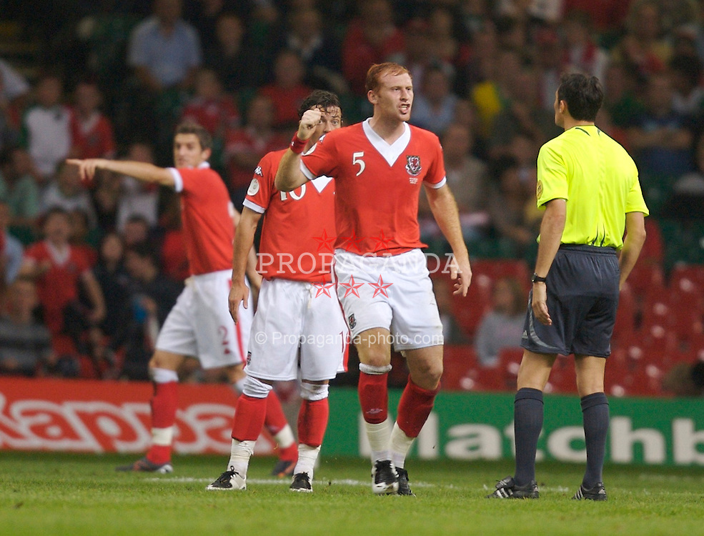 Cardiff, Wales - Saturday, September 8, 2007: Wales' James Collins argues with referee Manuel Gonzalez during the Euro 2008 Qualifying Group D match against Germany at the Millennium Stadium. (Photo by David Rawcliffe/Propaganda)