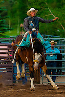 Saddle bronc riding competition, Snowmass Rodeo, Snowmass Village (Aspen), Colorado USA.