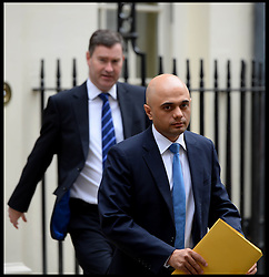 Financial Secretary to the Treasury Sajid Javid (FRONT) and Exchequer Secretary to the Treasury David Gauke (back) leave No10 Downing after the Budget Cabinet meeting and just before The Chancellor George Osborne poses on the steps of No11 Downing street with his red budget box for the 2014 Budget, London, United Kingdom. Wednesday, 19th March 2014. Picture by Andrew Parsons / i-Images<br /> File Photo - SAJID JAVID announced as new UK culture secretary following resignation of Maria Miller. Photo filed Wednesday Apr 09 2014.