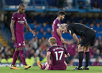Football - 2017 / 2018 Premier League - Chelsea vs Manchester City<br /> <br /> Kevin De Bruyne (Manchester City) sits down injured and is spken to by referee Martin Atkinson shortly before going off  at Stamford Bridge <br /> <br /> COLORSPORT/DANIEL BEARHAM