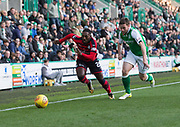 4th November 2017, Easter Road, Edinburgh, Scotland; Scottish Premiership football, Hibernian versus Dundee; Dundee's Roarie Deacon races past Hibernian's Lewis Stevenson