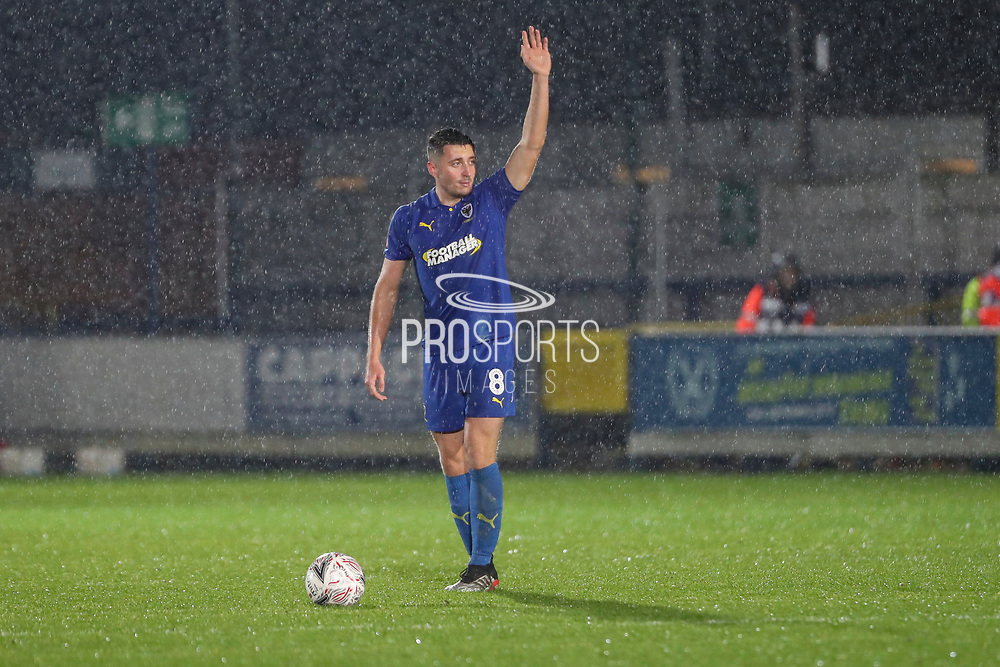 AFC Wimbledon midfielder Anthony Hartigan (8) about to take a free kick with hand in the air during the The FA Cup match between AFC Wimbledon and Doncaster Rovers at the Cherry Red Records Stadium, Kingston, England on 9 November 2019.