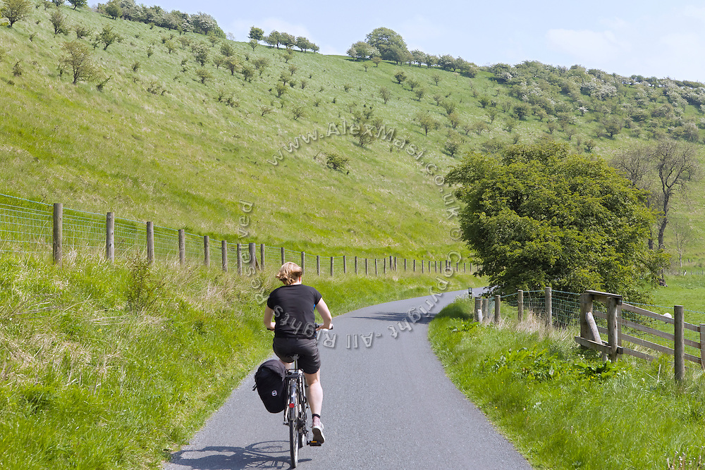 A tourist is cycling on the way to Thixendale, Yorkshire, England, United Kingdom.