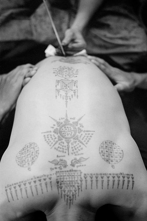 Thailand is a deeply spiritual country, in which both superstition and ritual tattooing play an active role.   Traditional Thai tattoos are known as Yantra tattoos.  They are believed to possess strong magical powers, which will protect the bearer as well as bring him or her good luck.  With their alleged ability to break knife blades and stop bullets, this form of tattooing is particularly favoured by soldiers and the police force as well as, inevitably, by members of the underworld.<br /> <br /> Thai culture is a rich mixture of many Asiatic religious traditions.  It encompasses Hinduism, Brahmanism, Animism and Buddhism.  Whilst being ingrained in Hindu culture, Yantra tattoos, known also in Thailand as &quot;Sak Yant&quot;, incorporate many elements from these other belief systems.  A further influence is taken from ancient Khmer Sanskrit texts, many of which are believed to possess magical powers. Yantra or Sak Yant tattooing is a widely practised form of sacred tattooing prevalent throughout Southeast Asia.  Adepts are to be found mainly in Cambodia, Laos and Thailand, although there is a growing interest in Singapore among Chinese Buddhists.  Sak Yant is usually performed by a &quot;whicha&quot; (magic) practitioner.  <br /> <br /> Today the best-known temple for Yant or Sak Yant tattooing is Wat Bang Phra.   This temple has an unbroken tattooing tradition dating back to the Ankor period.  The motifs and designs have evolved over the centuries, often as the result of visions received during sessions of intensive meditation.  <br /> <br /> Many Yant tattoos have been taken from images pertaining to pre-Buddhist Shamanism and its belief in multiple animal spirits. Most of these animalistic images come from the Southeast of the Asian sub-Continent and have subsequently been incorporated into Thai traditions and culture. The writing used in Yant designs is ancient Khmer
