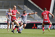 Samisoni Langi for Catalan Dragons kicks during the Betfred Super League match between Salford Red Devils and Catalan Dragons at the AJ Bell Stadium, Eccles, United Kingdom on 30 March 2018. Picture by George Franks.