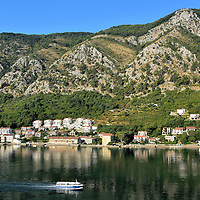 Bay of Kotor in Montenegro<br /> Montenegro, whose name means Black Mountain, is landlocked except for a stretch along the Adriatic coast. Near Croatia&rsquo;s southern border is the mouth of Boka Kotorska. The 17 mile long Bay of Kotor was formed by receding glaciers from the Dinaric Alps.  Some people refer to Boka as a fjord but it is actually a river canyon. This UNESCO World Heritage Site has four gulfs. Three of them &ndash; Tivat, Risan and Kotor - are surrounded by limestone mountains: Orjen and Lovćen. Nestled along its shores are serene towns. They are a joy to explore. This travel guide shows the highlights from Dobrota, Perast, Tivat and Budva.