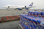 Cargo plane and cargo on tarmac, Accra, Ghana.