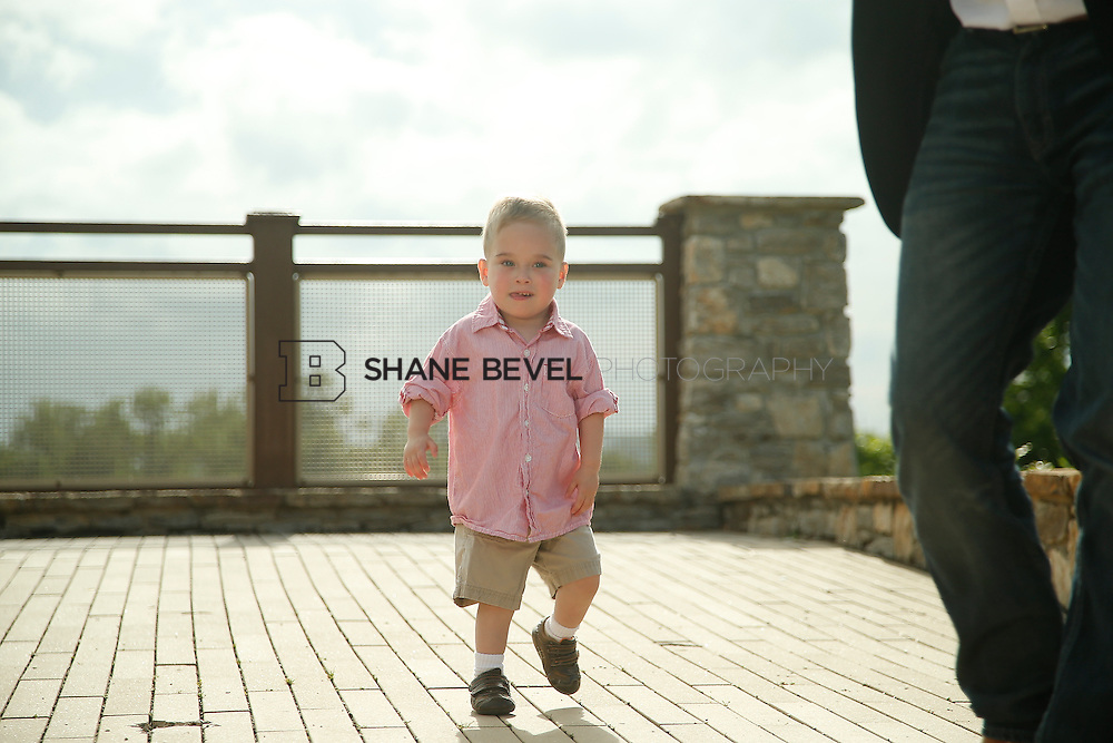 5/28/15 5:51:08 PM -- Miracle Miles and his family pose for portraits and play at the QuikTrip park for the 2015 Saint Francis Health System advertising campaign. <br /> <br /> Photo by Shane Bevel