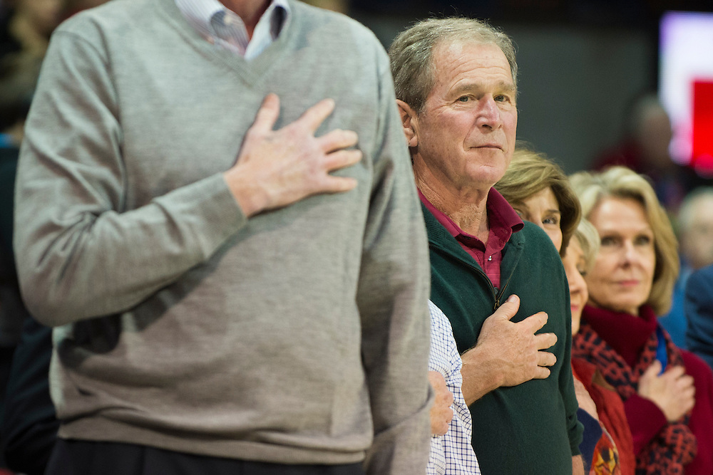 DALLAS, TX - DECEMBER 16: Former U.S. President George W. Bush stands during the National Anthem before tipoff between the SMU Mustangs and the Nicholls State Colonels on December 16, 2015 at Moody Coliseum in Dallas, Texas.  (Photo by Cooper Neill/Getty Images) *** Local Caption *** George W. Bush