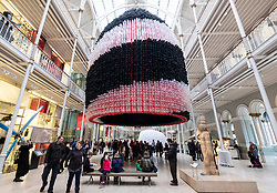 Edinburgh, UK. 6 April, 2018. Event Horizon balloon sculpture unveiled at National Museum of Scotland. American artist Jason Hackenwerth returns to Edinburgh with his biggest creation yet: a 30,000 strong balloon sculpture hanging from the top of the National Museum of Scotland's Grand Gallery. This will be currently the biggest balloon sculpture in the world.<br /> The installation is part of Edinburgh International Science Festival.