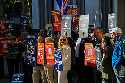 © Licensed to London News Pictures. 17/09/2019. London, UK. Protesters demonstrate outside UK Supreme Court in London as the court begins a three day appeal hearing in the multiple legal challenges against the Prime Minister Boris Johnson's decision to prorogue Parliament ahead of a Queen's speech on 14 October. Eleven instead of the usual nine Supreme Court justices will hear the politically charged claim that Boris Johnson acted unlawfully in advising the Queen to suspend parliament for five weeks in order to stifle debate over the Brexit crisis. It is the first time the Supreme Court has been summoned for an emergency hearing outside legal term time. Lady Hale, the first female president of the court who retires next January, will preside. Photo credit: Dinendra Haria/LNP