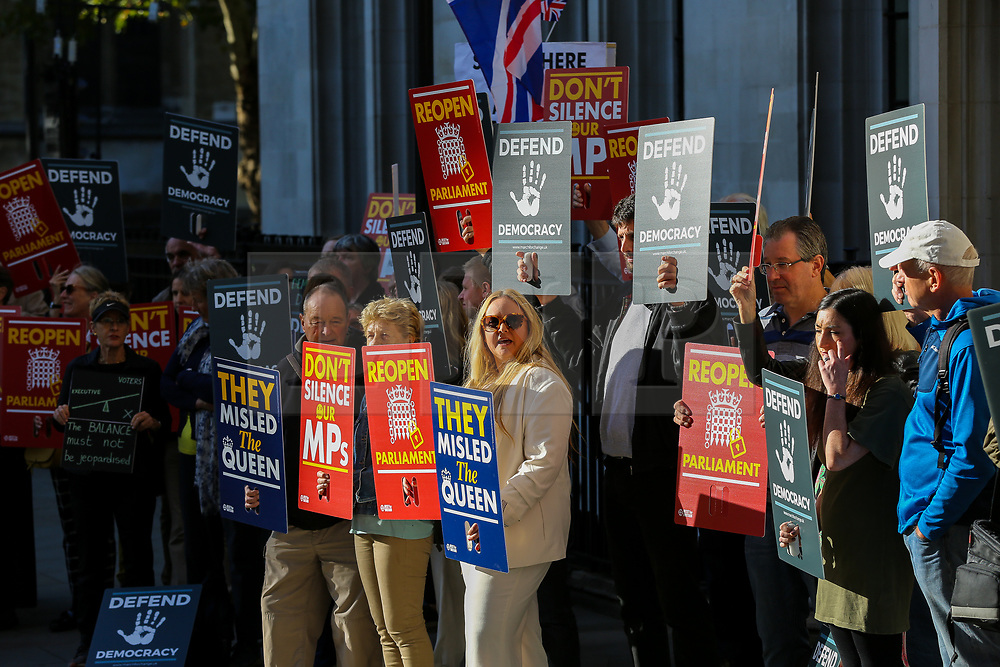 © Licensed to London News Pictures. 17/09/2019. London, UK. Protesters demonstrate outside UK Supreme Court in London as the court begins a three day appeal hearing in the multiple legal challenges against the Prime Minister Boris Johnson's decision to prorogue Parliament ahead of a Queen's speech on 14 October. Eleven instead of the usual nine Supreme Court justices will hear the politically charged claim that Boris Johnson acted unlawfully in advising the Queen to suspend parliament for five weeks in order to stifle debate over the Brexit crisis.It is the first time the Supreme Court has been summoned for an emergency hearing outside legal term time.Lady Hale, the first female president of the court who retires next January, will preside. Photo credit: Dinendra Haria/LNP