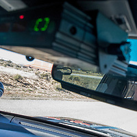 Ramah Navajo Police Officer Deirryck Clichee surveys the landscape of Pinehill during a patrol shift Monday.