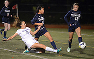 CB East's BrianaTalbot #31 takes a shot on net as Cedar Cliff's Libby Enck #11 and Cedar Cliff's Maddy Hindermyer #13 defend in the first half Tuesday November 10, 2015 in Doylestown, Pennsylvania.  (Photo by William Thomas Cain)