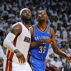 Jun 17, 2012; Miam, FL, USA; Miami Heat small forward LeBron James (6) and Oklahoma City Thunder small forward Kevin Durant (35) go for a rebound during the first quarter in game three in the 2012 NBA Finals at the American Airlines Arena. Mandatory Credit: Derick E. Hingle-US PRESSWIRE