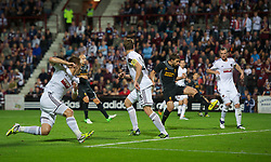 EDINBURGH, SCOTLAND - Thursday, August 23, 2012: Heart of Midlothian's Andrew Webster scores an own-goal under pressure from Liverpool's Fabio Borini during the UEFA Europa League Play-Off Round 1st Leg match at Tynecastle. It was the only goal of the game and handed the Reds a 1-0 away victory. (Pic by David Rawcliffe/Propaganda)