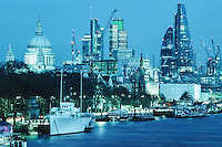 London city, at dusk, looking up the River Thames, towards St Paul's Cathedral, and the financial City of London