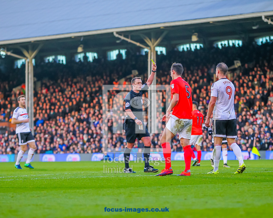 Matt Smith of Fulham receives a yellow card during the Sky Bet Championship match at Craven Cottage, London<br /> Picture by Richard Brooks/Focus Images Ltd 07947656233<br /> 02/01/2017