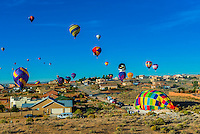 Hot air balloons landing near houses, Albuquerque International Balloon Fiesta, Albuquerque, New Mexico USA.