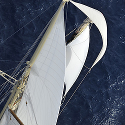 The 2010 Sailing yacht Atlantic is magnificent replica of the 1903 William Gardner designed three-masted sailing schooner Atlantic, owned by Ed Kastelein. The 1903 sailing schooner was a long time World record holder for the crossing of the Atlantic Ocean under sail in 1905 winning the KaiserÕs Cup from New York to The Lizard. The record held firm for almost a century, when it was broken in 1998. It is the longest standing speed record in the Yachting History. <br />The Owner, Ed Kastelein is the man responsible for the recreation of this wonderful new schooner Atlantic, and is also behind such projects as the sailing yacht Thendara, sailing yacht Aile Blanche, sailing yacht Borkumriff, sailing yacht Zaca a te Moana and most recently the Herreshoff racing schooner Eleonora E.<br /><br />The Dutch Van der Graaf yard first launched the Sailing Yacht Atlantic in 2008. Following her launch, she underwent an extensive programme of fitting out. 2009 saw the assembly of her three masts, with a height of 45 metres, supporting 1700m? of sails. Her raven black high gloss hull reflects the ripples of the water and one glance at the three towering masts, instantly give the sense of power that this mighty yacht Atlantic has.<br /><br />Sailing schooner Atlantic is the largest classic sailing schooner ever created, measuring 185 feet (56 metres) over deck and with the bowsprit to boom length of 227 feet (69 metres). Her graceful sheerline and long overhangs accentuate her grace while her waterline length of 42 meters and narrow beam are a promise for unmatched speed under sail.<br /><br />On June 23rd 2010, sailing schooner Atlantic sailed out to sea, three years after her keel was laid. The Owner, Ed Kastelein, saw his long term dream come true, as he witnesses his family, guest and crew step on board of Atlantic yacht. Her maiden voyage was a two month leisurely cruise from Rotterdam to Cannes and she exceeded all expectations, sailing fast at every point of sail with amazing e