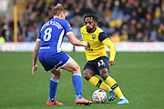 Oxford United midfielder Tarique Fosu-Henry  (11) battles for possession  with Hartlepool United midfielder Nicky Featherstone (8) during the The FA Cup match between Oxford United and Hartlepool United at the Kassam Stadium, Oxford, England on 4 January 2020.