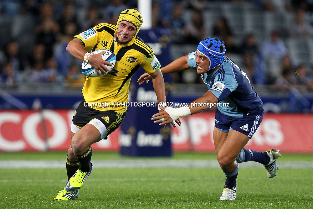 Hurricanes' Andre Taylor beats Blues' Benson Stanley on the outside. Super Rugby rugby union match, Blues v Hurricanes at Eden Park, Auckland, New Zealand. Friday 23rd March 2012. Photo: Anthony Au-Yeung / photosport.co.nz