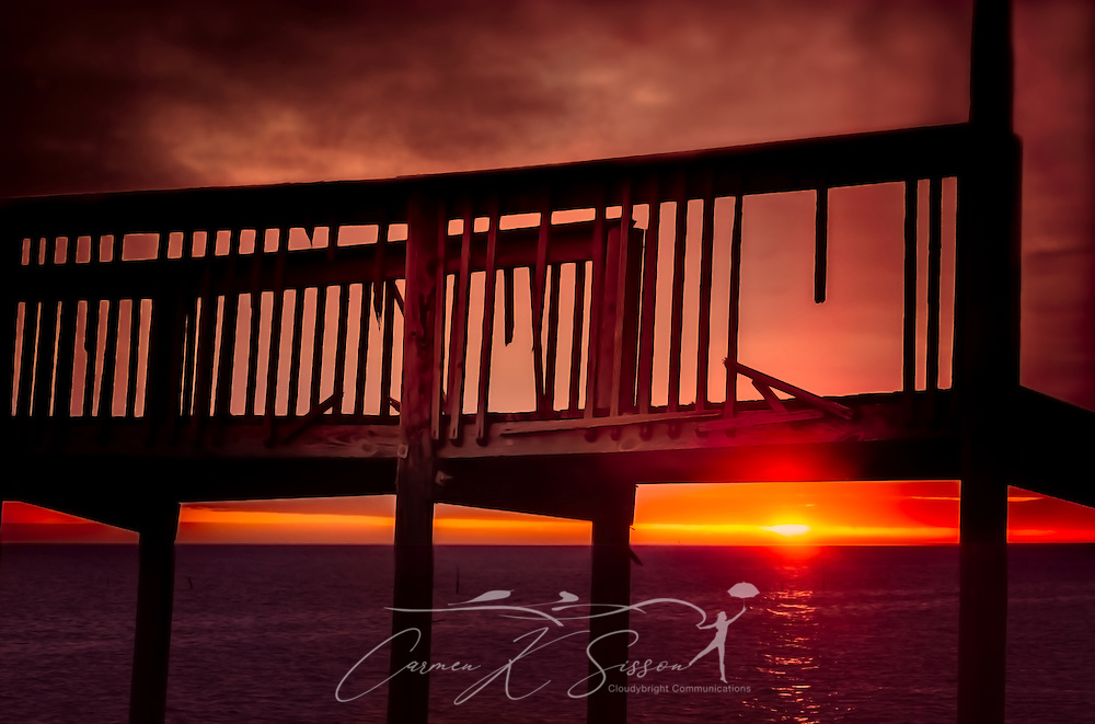 The sun sets on Bayou La Batre Beach, January 25, 2015, in Bayou La Batre, Alabama. The wharf was damaged by Hurricane Katrina in 2005.  (Photo by Carmen K. Sisson/Cloudybright)
