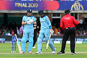 Wicket - Joe Root of England looks dejected as he walks past Jonny Bairstow of England on his way back to the pavilion after being dismissed by Colin de Grandhomme of New Zealand during the ICC Cricket World Cup 2019 Final match between New Zealand and England at Lord's Cricket Ground, St John's Wood, United Kingdom on 14 July 2019.