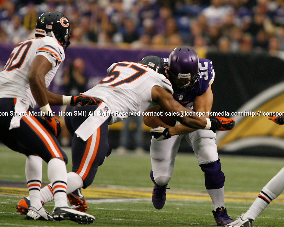 Dec 1, 2013; Minneapolis, MN, USA;  Minnesota Vikings Running Back Toby Gerhart (32) [8546] is wrapped up by Chicago Bears Linebacker Jon Bostic (57) [18376] in the first quarter at Mall of America Field