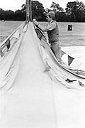 Man putting up a tent, Glastonbury, Somerset, 1989