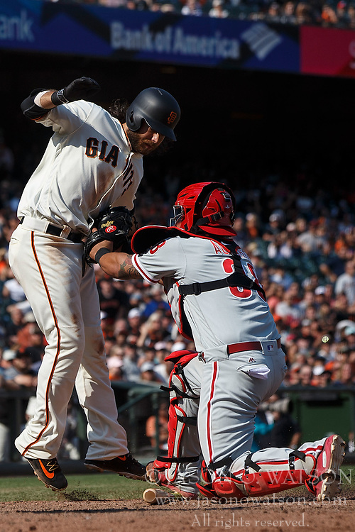 SAN FRANCISCO, CA - AUGUST 20: Brandon Crawford #35 of the San Francisco Giants is tagged out at home plate by Jorge Alfaro #38 of the Philadelphia Phillies during the ninth inning at AT&T Park on August 20, 2017 in San Francisco, California. The Philadelphia Phillies defeated the San Francisco Giants 5-2. (Photo by Jason O. Watson/Getty Images) *** Local Caption *** Brandon Crawford; Jorge Alfaro