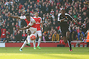 Arsenal striker, Danny Welbeck (23) shot on goal and miss during the The FA Cup Quarter Final match between Arsenal and Watford at the Emirates Stadium, London, England on 13 March 2016. Photo by Matthew Redman.
