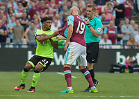 Football - 2016 / 2017 Premier League - West Ham United vs. AFC Bournemouth<br /> <br /> Bournemouth's Jordon Ibe reacts angrily to being shoved by James Collins of West Ham  as he walks to the touchline at The London Stadium.<br /> <br /> COLORSPORT/DANIEL BEARHAM