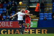 Bolton Wanderers midfielder Liam Feeney  and MK Dons defender Dean Lewington battle in the air during the Sky Bet Championship match between Bolton Wanderers and Milton Keynes Dons at the Macron Stadium, Bolton, England on 23 January 2016. Photo by Simon Davies.