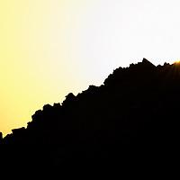 Oman, Al-Ayn. January/30/2008...Sun setting on the rocky landscape surrounding Al-Ayn.