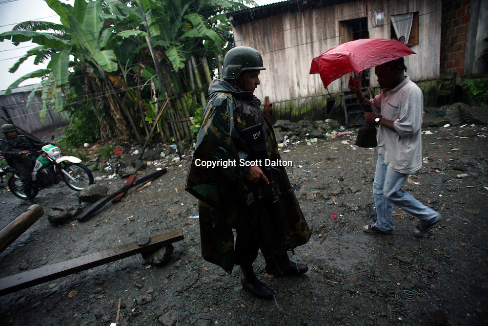 Police patrol in Lleras, a poor barrio in Buenaventura, on the Pacific Coast of Colombia, on Tuesday, May 15, 2007. Buenaventura is in the midst of a spree of violence over control of drug shipments from the poor barrios in the city. Many of the neighborhoods have a strong presence of FARC militias that control most of the drug trade in the city. (Photo/Scott Dalton)