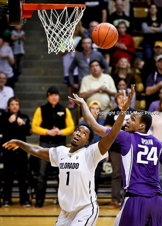 SHOT 1/22/15 10:10:27 PM - Colorado's Wesley Gordon #1 fights for a rebound with Washington's Robert Upshaw #24 during their regular season Pac-12 basketball game at the Coors Events Center in Boulder, Co. Washington won the game 52-50 on a shot with less than a second to play in the game. (Photo by Marc Piscotty / © 2015)