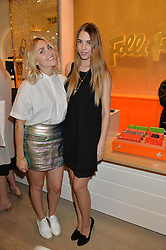 Left to right, BECKY TONG and AMBER LE BON at the launch the Folli Follie Flagship store at 493 Oxford Street, London on 28th May 2015.