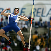 A pole vault competitor from Air Force decends after clearing the bar at the Drake Relays.  Des Moines, Ia., April 25, 2009 - DRAKE RELAYS PHOTOGRAPH BY DAVID PETERSON -