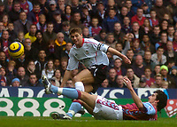 Photo: Glyn Thomas.<br />Aston Villa v Liverpool. The Barclays Premiership. <br />05/11/2005.<br />Liverpool's Steven Gerrard (L) is tackled by Liam Ridgewell.