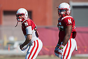 March 27, 2013: Quarterback Taylor Martinez (left) and I-back Imani Cross (right) getting instructions during practice at Hawks Championship Center in Lincoln, Nebraska.